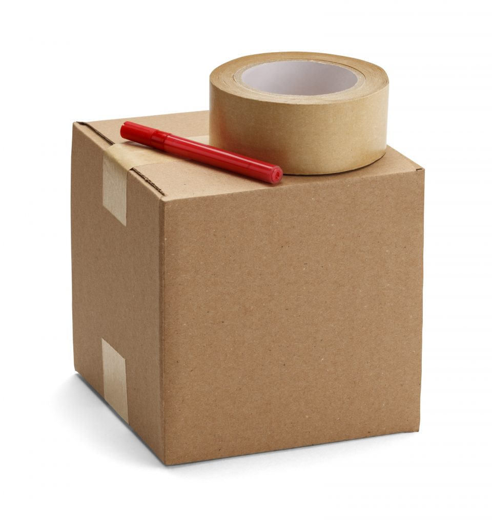 Brown cardboard box with packaging materials isolatedon a white background.